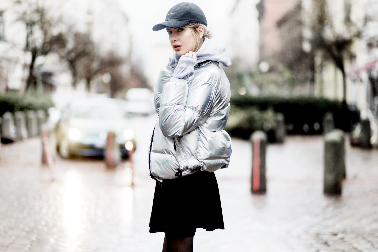 BERLIN, GERMANY - DECEMBER 2: Ebba Zingmark (fashion blogger) wearing a silver down feather jacket from Bixtol, a grey hoody and black cap from thatboii, a black velvet mini skirt nobodys child, H&M tights on December 2, 2016 in Berlin, Germany. (Photo by Christian Vierig/Getty Images) *** Local Caption *** Ebba Zingmark